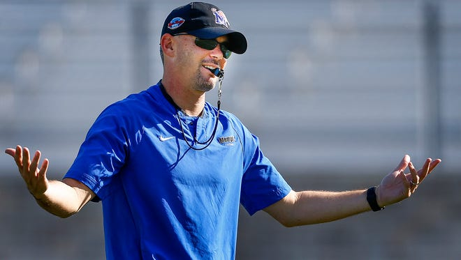 University of Memphis head football coach Mike Norvell reacts to the music selection during a morning practice in West Palm Beach, Fl., as they prepare for their upcoming Boca Raton Bowl game against Western Kentucky University.
