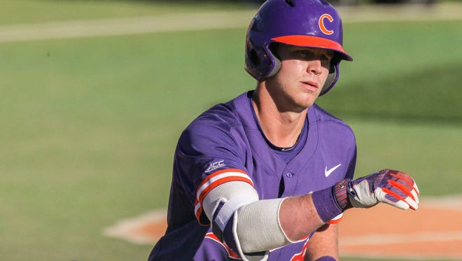 Clemson sophomore first baseman Seth Beer (28) tosses his bat after being walked during a game earlier this season.