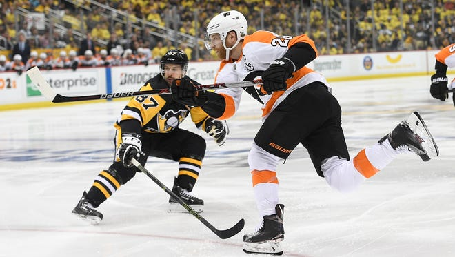 Claude Giroux took a hit from Sidney Crosby Friday night and hit Kris Letang off-balance.
