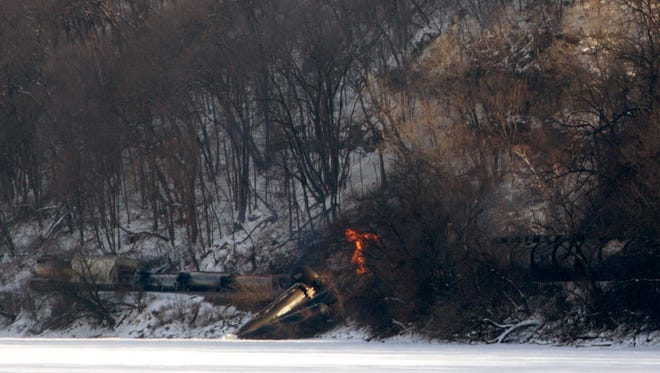 Iowa Department of Natural Resources staff are on the scene of a train derailment in which three railcars caught fire and another three plunged into the Mississippi River. In all, 11 cars derailed, and 10 of them were carrying ethanol, north of Dubuque, Iowa, on Wednesday, Feb. 4, 2015.