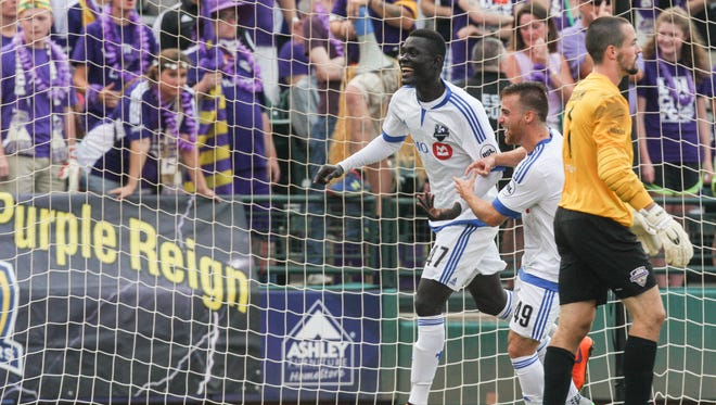 Montreal's Jacques Haman, left, celebrates with teammate Alessandro Riggi following a first half goal against Louisville City on Wednesday night as goalie Scott Goodwin looks on. Aug. 5, 2015