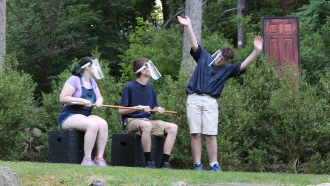 """Gabe (Noah Bryant) shows Maria (Olivia Pike) and Paul (Josh Lightner) what to expect on the coaster ride in the short play """"Coaster,"""" as part of Sauk Shorts starting Thursday at the Hillsdale College Slayton Arboretum."""