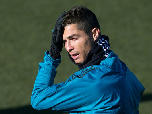 Real Madrid's Cristiano Ronaldo attends a training session in Madrid, Tuesday Dec. 5, 2017. Real Madrid will play Borussia Dortmund Wednesday in a Group H Champions League soccer match. (AP Photo/Paul White)