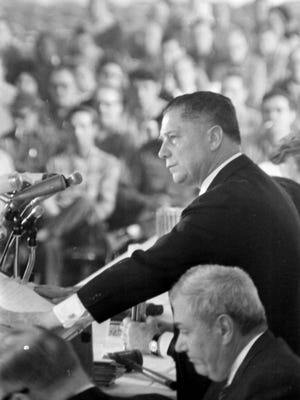 Teamsters president  Jimmy Hoffa  addresses an  audience at Cobo Hall in Detroit,   with Frank Fitzsimmons, seated, on his right, in 1966.   He vanished in 1975; his body has never been found.