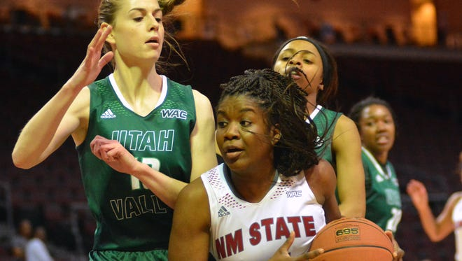 New Mexico State's Moriah Mack drives the lane against Utah Valley's Karlee Norris during the WAC Tournament semifinals on Friday in Las Vegas.