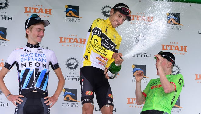 Lachlan Morton, of Jelly Belly Racing & pb Maxxis, center, sprays the others on the podium after his winning the Tour of Utah bicycle race, Sunday, Aug. 7, 2016. To the left is second place winner, Adrien Costa, and at right is third place finisher Andrew Talansky. (Scott Sommerdorf/The Salt Lake Tribune via AP)