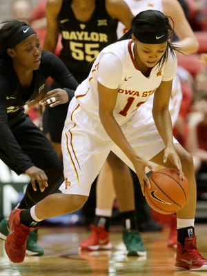 Baylor guard Alexis Jones, left, tries to steal the ball from Iowa State guard Seanna Johnson during the second half of an NCAA college basketball game, Saturday, Jan. 23, 2016, in Ames, Iowa. Baylor won 77-61.