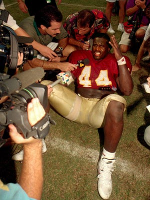 FSU fullback William Floyd didn't want to leave the field after the Seminoles beat Miami in 1993. So he held court with reporters on the turf at Doak Campbell Stadium.