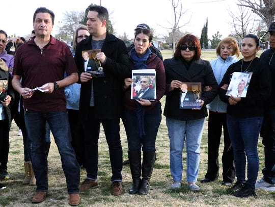 Moises Ramirez, left, and other family members talk