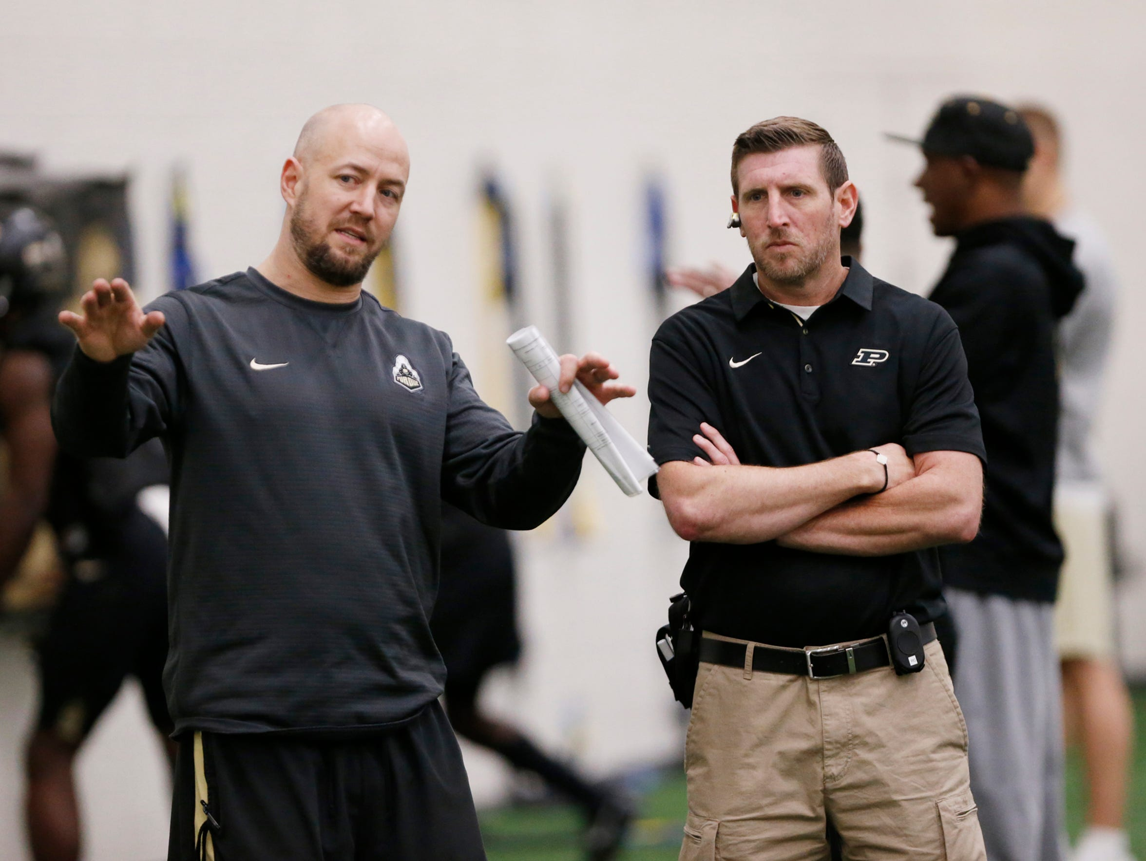 Justin Lovett, left, director of football strength