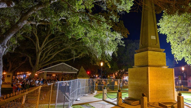 A temporary fence and plywood surround the Confederate memorial on the Plaza de la Constitucion in St. Augustine on Monday, June 22, 2020. The fence and wood were added after the City Commission voted to move the obelisk from the plaza.