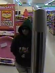 This woman shown leaving the Family Dollar store in Fayetteville on March 12 is suspected of robbing the store.