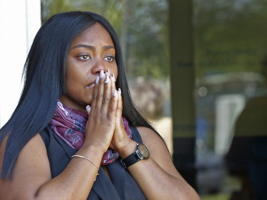 Ashley Farris pauses a teary moment at the Caring Place, before the Celebration of Life for Warren Central football star Dijon Anderson, her cousin, Wednesday, May 31, 2017.