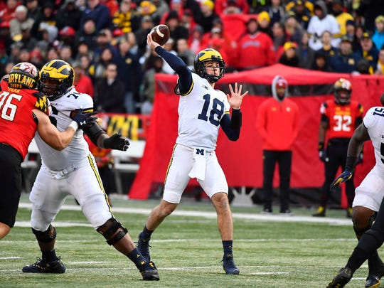 Michigan quarterback Brandon Peters throws a touchdown pass against Maryland in the first half Saturday, Nov. 11, 2017 in College Park, Md.
