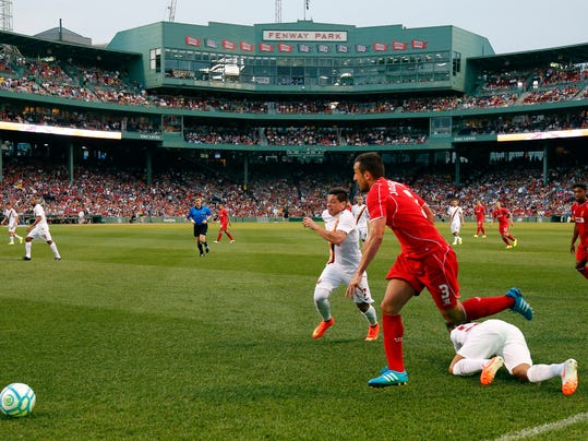 Liverpool FC defender Jose Enrique (3) chases the ball against AS Roma during a friendly soccer match at Fenway Park in Boston, Wednesday, July 23, 2014. (AP Photo)