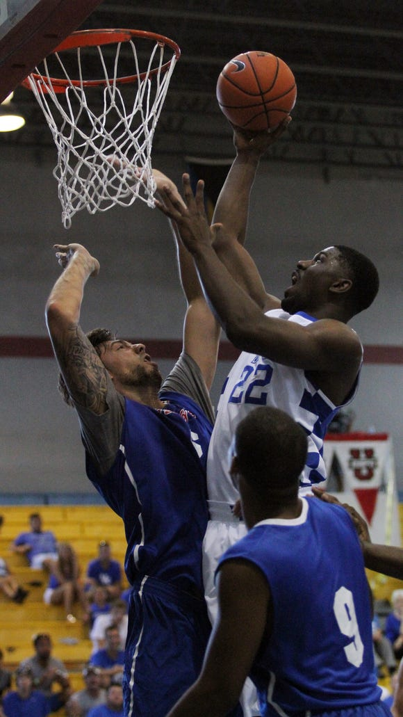 University of Kentucky's Alex Poythress scores during the team's exhibition game against Puerto Rico in Nassau, Bahamas, August 12, 2014. Photo by Drew Fritz, Special to the Courier-Journal