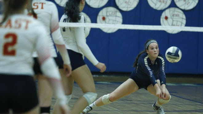 Pittsford Sutherland's Giuliana Johnson saves a point against Williamsville East in the second set at Victor High School.