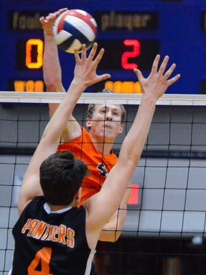 Wyatt Hughes of Northeastern slams the ball past Central York blocker Matthew Minkin during the York-Adams League boys' volleyball championship, Tuesday, May 15, 2018. Hughes and the Bobcats will play for the state 2-A title at 11 a.m. Saturday vs. Manheim Central. John A. Pavoncello photo