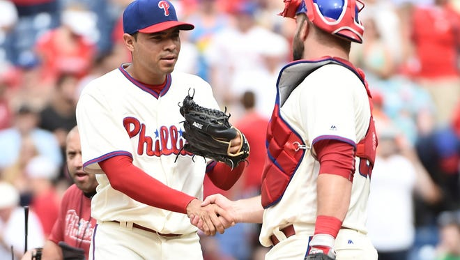 Philadelphia Phillies relief pitcher Jeanmar Gomez and catcher Cameron Rupp celebrate a win July 3 against the Kansas City Royals at Citizens Bank Park. Both players could be traded before the Aug. 1 deadline.