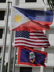 In this June file photo, a flag raising ceremony was held for the 117th anniversary of the proclamation of Philippine Independence at the Guam Reef and Olive Spa Resort.