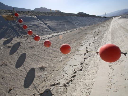 Buoys hang over a dry canal that leads to a groundwater replenishment facility on the outskirts of Palm Springs.