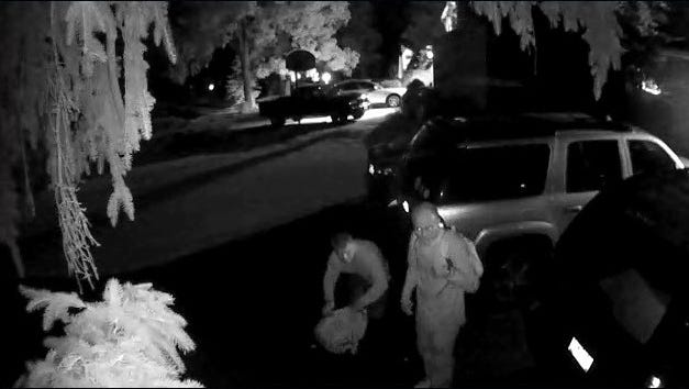 Video surveillance footage captured two suspects entering cars Tuesday morning.