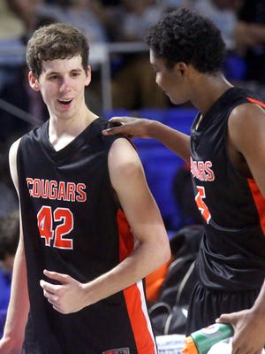 MTCS 's senior Luke Howell (42) talks with Kavan Hill (5) as they walk off the court together after losing to Mitchell in the state tournament quarterfinal game  on Thursday March 17, 2016, at MTSU.
