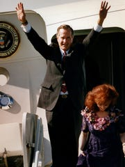 President George Bush waves to the crowd at the Ft.