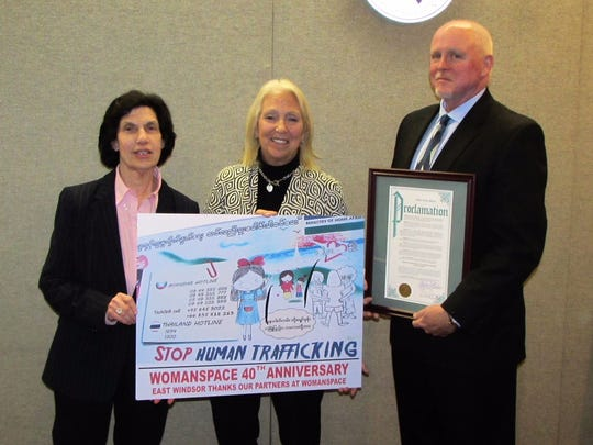 East Windsor Township Mayor Janice S. Mironov issued a Mayoral Proclamation recognizing January as Human Trafficking Awareness Month. Mironov presented Womanspace with a sign commemorating its 40th anniversary that features a picture of an anti-human trafficking billboard she saw near the border of Myanmar and Thailand, during a recent trip to Southeast Asia. From left: Mayor Janice S. Mironov; Patricia Hart, executive director of Womanspace; and retired East Windsor Police Chief Bill Spain.