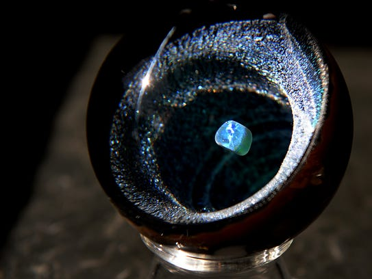 A Sand Spirit Glass marble created by artist Jamie