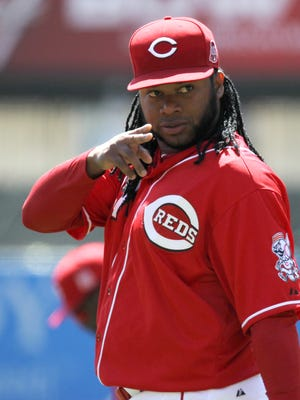Cincinnati Reds starting pitcher Johnny Cueto (47) points to the dugout prior to the game against the St. Louis Cardinals, Saturday, April 11, 2015, at Great American Ball Park.