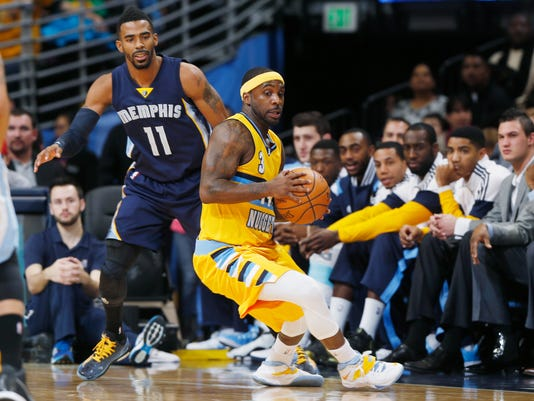 Denver Nuggets guard Ty Lawson, front, pulls in a loose ball as Memphis Grizzlies guard Mike Conley covers in the first quarter of an NBA basketball game Saturday, Jan. 3, 2015, in Denver. (AP Photo/David Zalubowski)