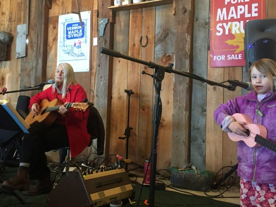 Paige Palmer, 6, right, sings with Mary Provencher of band Mystic Party. Palmer's parents own Palmer's Sugarhouse in Shelburne, which participated in the Maple Open House Weekend on Sunday, March 26, 2017.
