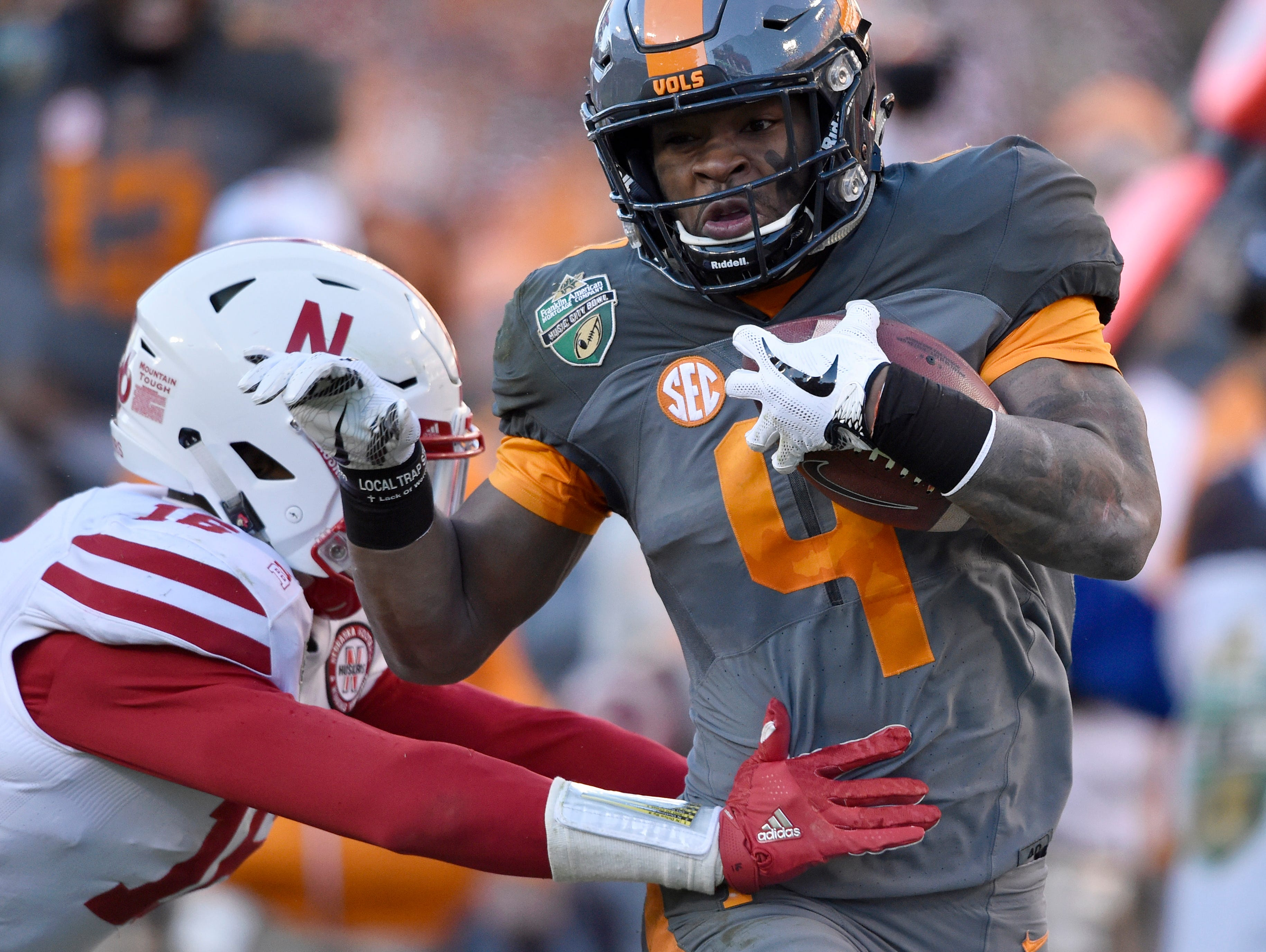 Nebraska Cornhuskers safety Antonio Reed (16) can't stop Tennessee Volunteers running back John Kelly (4) on his way to the Vols' first touchdown in the first half of the Franklin American Mortgage Music City Bowl at Nissan Stadium in Nashville, Tenn., Friday, Dec. 30, 2016.