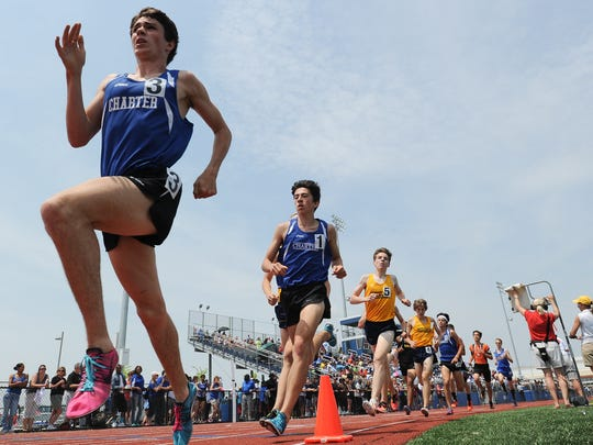 Runners compete in the Division I 1600 meter race at the state track meet Saturday at Dover High School.