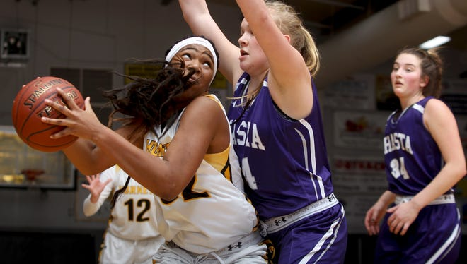 Enterprise's Justyse Cooper, left, goes up against Shasta High's Aida Kowalski in Enterprise's 59-56 overtime victory Friday night.