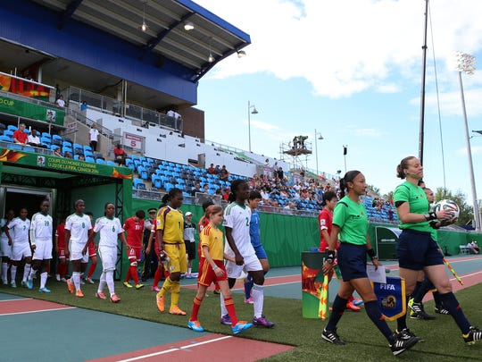 Referee Margaret Domka to the United States leads the teams out prior to kickoff of the FIFA U-20 Women's World Cup Canada 2014 Semi Final match between Korea DPR and Nigeria at Moncton Stadium on August 20, 2014 in Moncton, New Brunswick, Canada. (Photo by Vaughn Ridley/Getty Images)