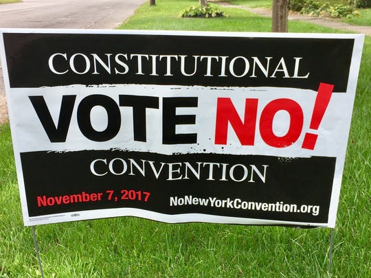 Signs opposing a New York constitutional convention