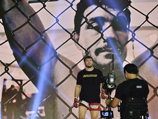 Former Purdue football player, now MMA pro fighter Matt Mitrione, prepares to walk to the cage to face Carl Seumanutafa at Bellator 157 on June 24, 2016.