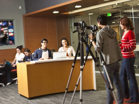 Students enjoy the use of the latest technologies in the newly renovated Newsroom at the Donald W. Reynolds School of Journalism and Center for Advanced Media Studies at the University of Nevada, Reno.