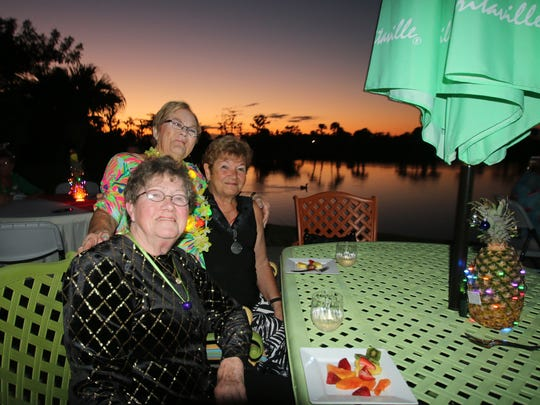 Coraljean Dwyer, Pat Bovee and Joan Douglas enjoy the gorgeous sunset during the Silver Bells Holiday Home Tour.