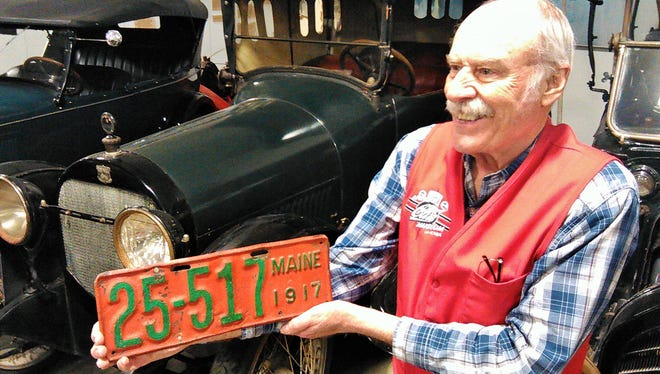 Museum volunteer Dave Kyllingstad displays the 1917 Maine license plate found in a recycling box by the Johnson County treasurer. It was then appropriately attached to this 1917 Haynes at the Antique Car Museum of Iowa in Coralville.