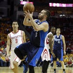 Dallas Mavericks guard J.J. Barea (5) shoots the ball during the fourth quarter against the Houston Rockets in game five of the first round of the NBA Playoffs at Toyota Center.