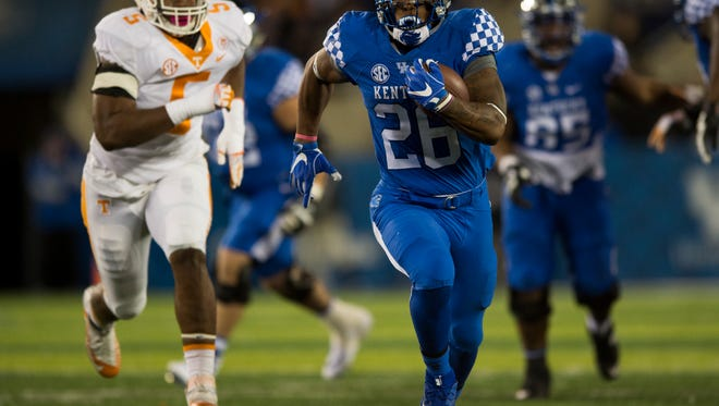 Kentucky running back Benny Snell Jr. (26) outruns Tennessee defenders during Tennessee's game against Kentucky at Kroger Field in Lexington on Saturday, Oct. 28, 2017.