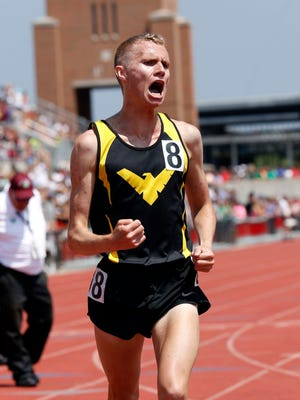 Colonel Crawford's Chad Johnson reacts after repeating as Division III 3200 meter champ in a state record 9:05.4.