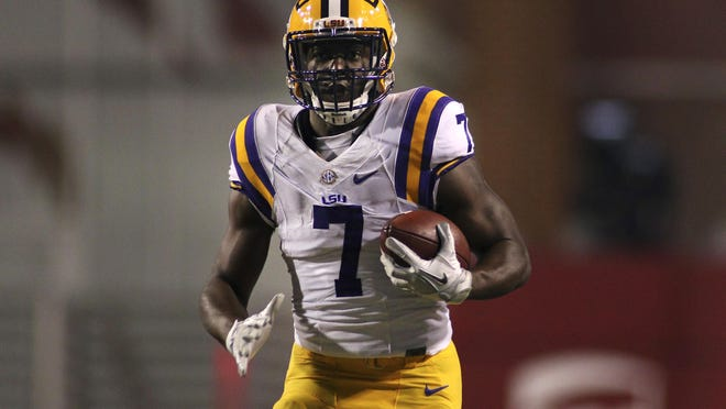 LSU's Leonard Fournette (7) rushes down the field during the first half of an NCAA college football game against Arkansas, Saturday, Nov. 12, 2016, in Fayetteville, Ark.