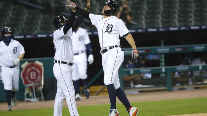 Detroit Tigers' JaCoby Jones celebrates his two-run inside-the-park home run in the seventh inning of a baseball game against the Chicago White Sox in Detroit, Monday, Aug. 10, 2020.