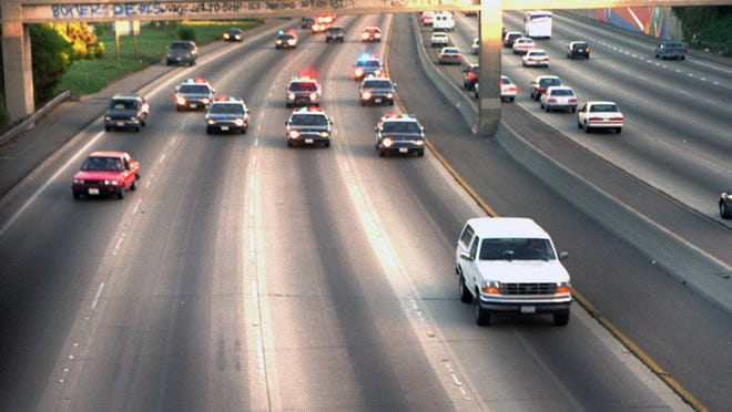 A white Ford Bronco, driven by Al Cowlings carrying O.J. Simpson, is trailed by Los Angeles police cars June 17, 1994, in Los Angeles.