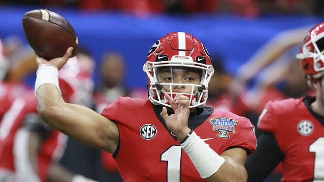 Jan. 01, 2019 New Orleans: Georgia quarterbacks Justin Fields (1) and Jake Fromm warm up for the team's Sugar Bowl NCAA college football game against Texas on Tuesday, Jan. 1, 2019, in New Orleans. (Curtis Compton/Atlanta Journal Constitution via AP) ORG XMIT: GAATJ325