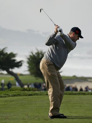 Michigan football coach Jim Harbaugh and his partner Matt Bettencourt combined to shoot a 7-under 67 on Friday in the Pebble Beach Pro-Am.